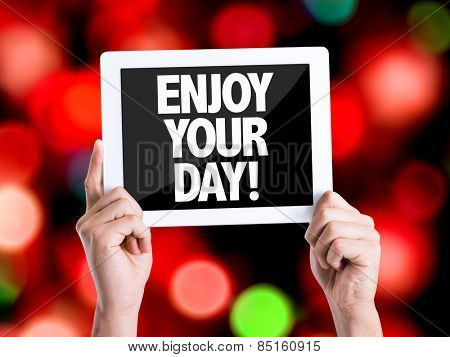 Tablet pc with text Enjoy Your Day with bokeh background