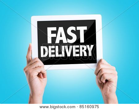 Tablet pc with text Fast Delivery with blue background