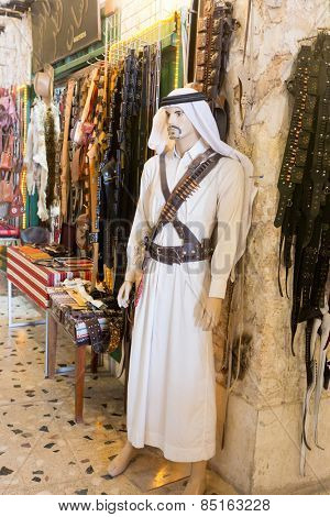 DOHA, QATAR - MARCH 8, 2015: Mannequin of a Qatari bedoin warrior outside a souvenir shop in Souq Waqif, Doha.