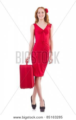 Woman in red dress and travel case isolated on white