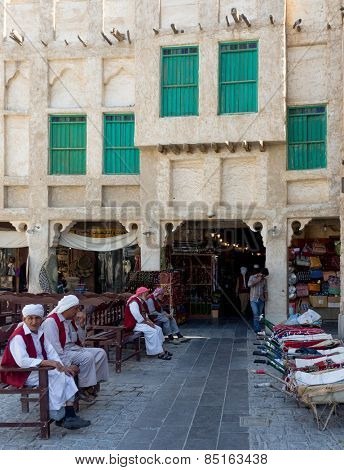 DOHA, QATAR - MARCH 8, 2015: Porters with their barrows await work outside part of the imposing Souq Waqif tourist attraction