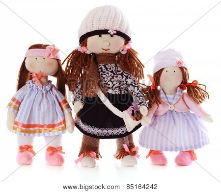Handmade dolls isolated on white