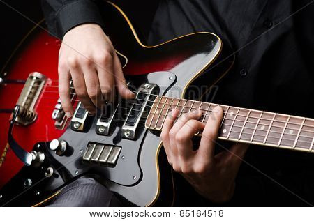 Man with guitar during concert