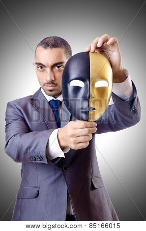 Businessman with mask in hypocrisy concept
