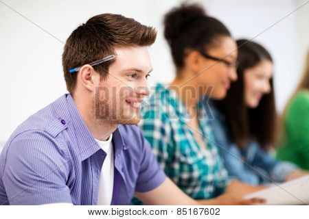 education concept - student with computer studying at school