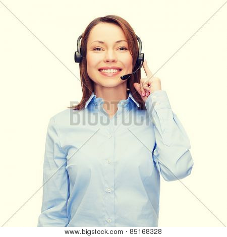 business, technology and call center concept - friendly female helpline operator with headphones