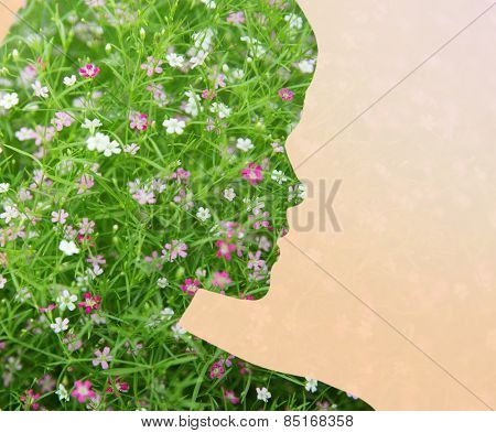 beauty, people, spring, summer seson and health concept - woman silhouette with green floral pattern