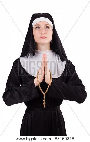 Young praying nun with beads isolated on white