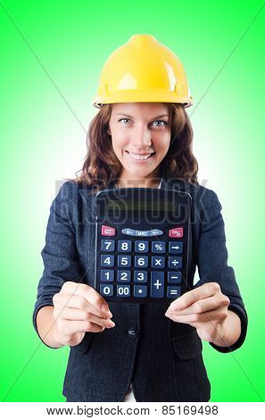 Female builder with calculator