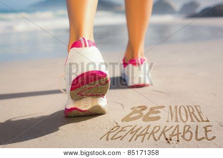 Fit woman walking on the beach against be more remarkable