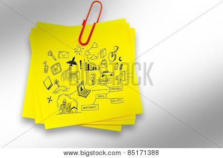 Brainstorm graphic against sticky note with red paperclip