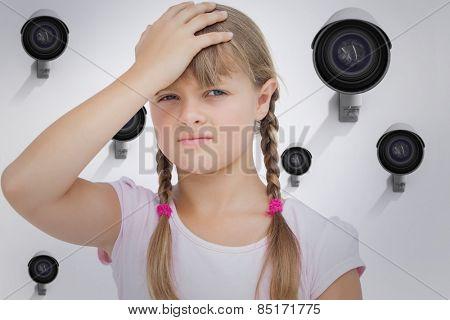 Little girl suffering from headache against cctv camera