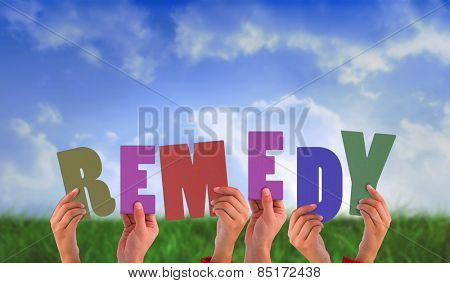 Hands holding up remedy against field of grass under blue sky