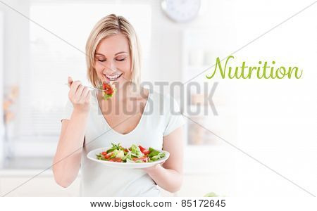 The word nutrition against gorgeous woman eating salad