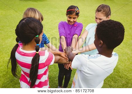 Children holding hands together at the park