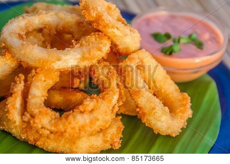seafood snacks, calamaris, squid rings served in outdoor restaurant, asian cuisine