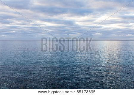 Ocean With Morning Clouds Gives A Harmonic Pattern