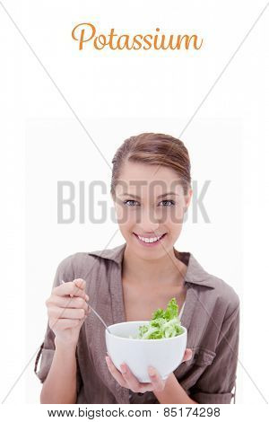 The word potassium against woman with bowl of salad