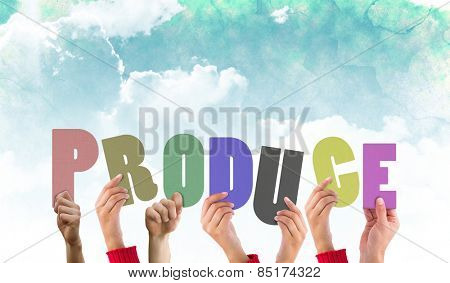 Hands holding up produce against green and blue sky