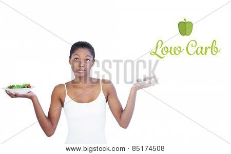 The word low carb against conflicted woman deciding to eat healthily or not