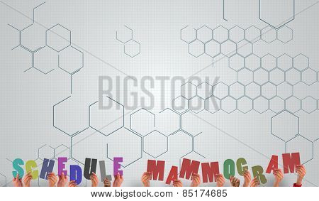 Hands holding up schedule mammogram against chemical structure in grey and white