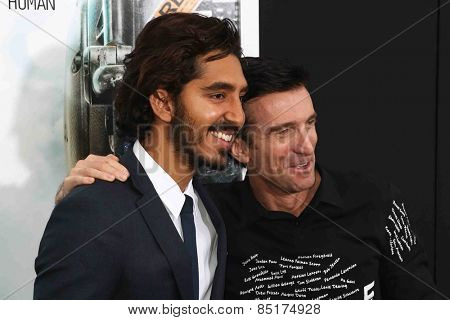 NEW YORK-MAR 4: Actor Dev Patel (L) and Sharlto Copley attend the premiere of