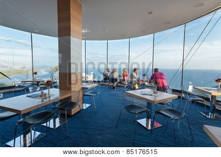 DUBROVNIK, CROATIA - MAY 26, 2014: People sitting in restaurant near Dubrovnik cable car station. Cable car connects Ploce and mountain Srdj above town where you can enjoy a panoramic view of Old Town