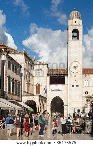 DUBROVNIK, CROATIA - MAY 28, 2014: Tourists walking on Stradun. Stradun is 300 meters long main pedestrian street in Dubrovnik.