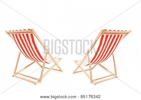 Studio shot of a two sun loungers isolated on white background
