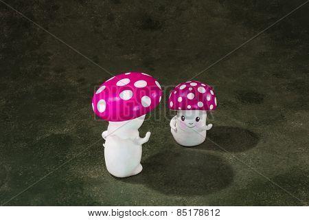cute puppet handmade, two mushrooms, gray background