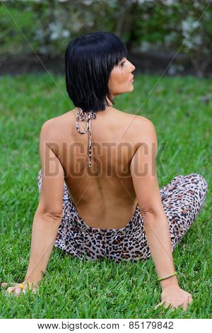 Woman posing with back towards camera