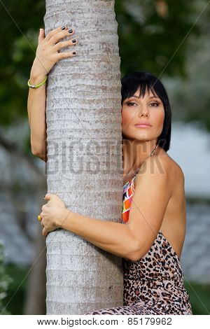 Female posing by a tree stock image