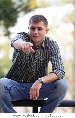 Man pointing finger at camera