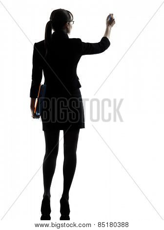 one business woman writing holding folders files silhouette studio isolated on white background