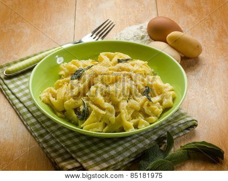 homemade tagliatelle with butter sage and parmesan cheese