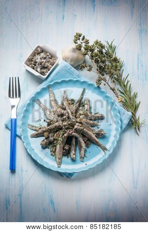 raw anchovies with capers herbs and olive oil