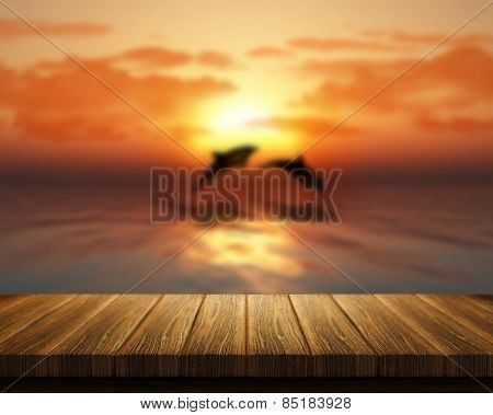 3D render of a wooden table looking out to sea with dolphins jumping