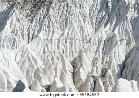 Detailed photo of white rock formations from above in Cappadocia, Turkey