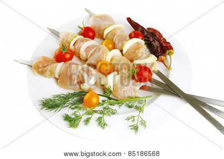 chicken shish kebab served on white plate