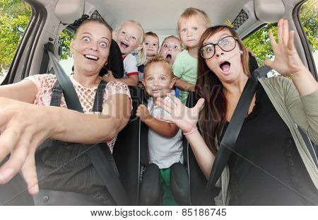 Crazy family taking a selfie in the car. Vintage filtered look