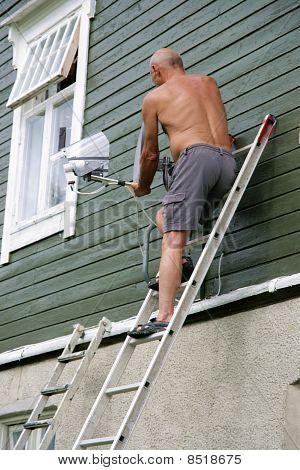 Man adjusting antenna
