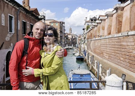 happy young romantic couple in love  travel and have fun in venice