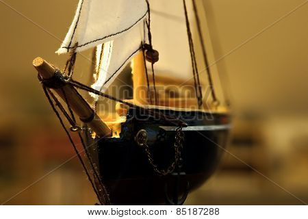 Closeup of a model sailing boat.