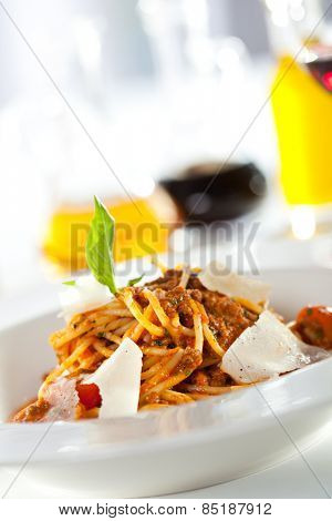 Spaghetti Bolognese with Parmesan Cheese and Fresh Basil Leaf