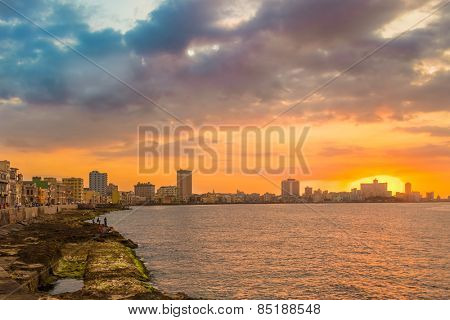 Beautiful colorful sunset in Havana with a view of the ocean and the city skyline