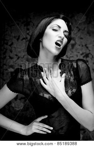 Fashion art girl portrait.Vamp style. Glamour vampire woman.Studio shot.