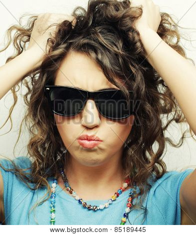happy teen girl with sunglasses over white background