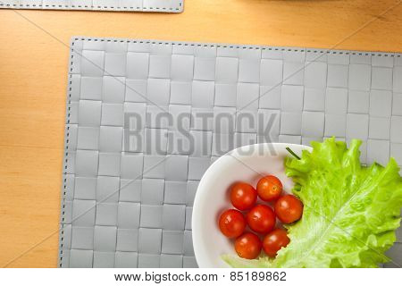 fresh vegetables on the table, grey place mat background