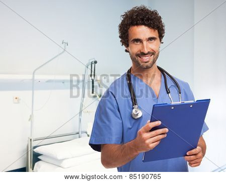 Portrait of a smiling doctor in a bright clinic room