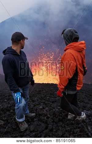 Eruption Tolbachik Volcano On Kamchatka, Tourists Watch The Fountain Lava Escaping From Volcano
